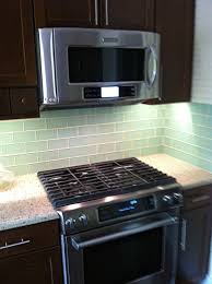 interior green glass subway tile backsplash with grills and