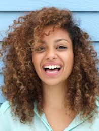 puffy woman curly hair 10 reasons you need to stop hating your curly hair gurl com