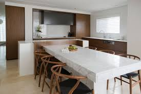 the stylish apartment space solutions designed by minosa design architecture marble table dining room and kitchen apartment design with wooden chair and wall mounted