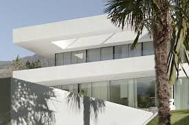 amazing white minimalist house painting with grasses yard and