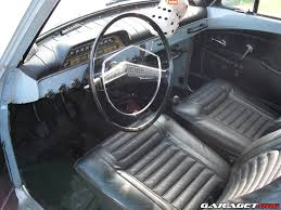 volvo station wagon interior interior of horizon blue volvo amazon 122s with dangly dice i