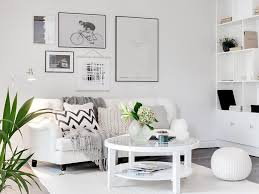 built in cabinetry area rug sofa crisp white gallery wall knit