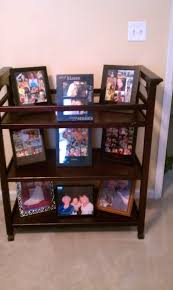 Repurpose Old Furniture by Changing Table Used To Display Favorite Photos Love This Idea To