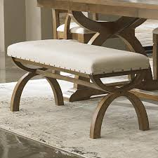 upholstered bench with unique curved x base by liberty furniture