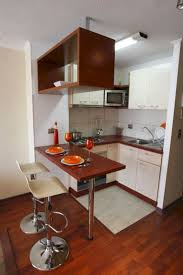 Tiny Kitchen Renovation With Faux by Appliances Stylish Tiny Kitchen Design With Wooden Breakfast Bar