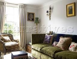 dp026 04 green corduroy sofa with armchair at sunlit narratives