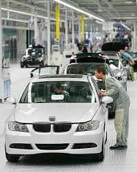 bmw car plant photos et images de bmw inaugurates production line in leipzig