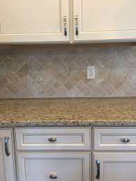 Herringbone Kitchen Backsplash White Kitchen With Satin Nickel Fixtures Pendant Lights