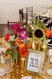 diy gold painted bottle centerpieces for wedding tablescapes mon