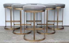 milo baughman burnished brass bar stools in grey leather at 1stdibs