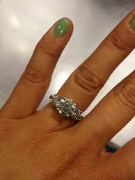 18 carat diamond ring size 4 finger my center is 1 6 cts and the side stones are