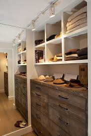 lacquered wood cabinet and minimalist shelves in spacious closet