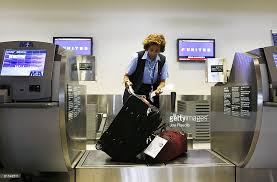 check in bag united united becomes second major airline to charge for first checked bag