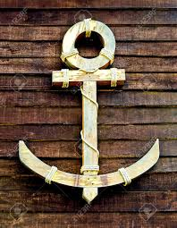 the wooden anchor on wood wall background stock photo picture