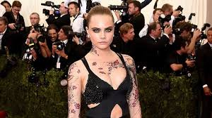 a complete guide to cara delevingne u0027s tattoos and their meanings