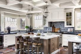 wood kitchen cabinets with white island 4 kitchens with white cabinets and a wood island