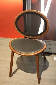 new dining room chairs offer style and comfort two mirror image curved ovals come together in this simple yet stunning dining chair from tonon