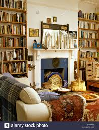 tall bookshelves on either side of fireplace in ethnic style