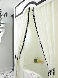 White Curtains With Pom Poms Decorating Black And White Bathroom Features Drop In Bathtub Adorned With
