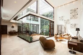 glass walled courtyard takes center stage in this unique indian