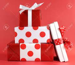 stack of red and white polka dot theme festive gift box presents