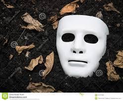 white halloween mask scary halloween mask on the ground stock photo image 61337631