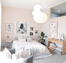 pastel pink and grey scandinavian nordic bedroom with asymmetrical