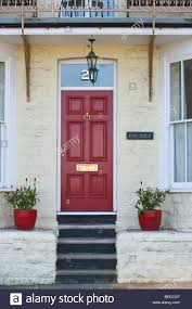 red number 2 front door of house with sash windows in scarborough