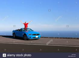 sky blue mustang in a sky blue ford mustang convertible by the sea big