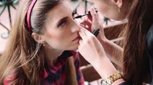 Professional Makeup Artistry Makeup Artist Applying Professional Make Up On The Face Of The