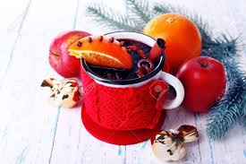 orange spice color mug of mulled wine with piece of orange spice branch of christmas