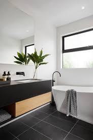 modern black and white bathroom with black tile matte black plumbing fixtures
