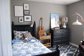 afforable simple design of the teenage boys bedrooms that has grey minimalist grey concrete wall inside the teenage boys bedrooms that can be decor with black cabinet