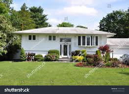 suburban high ranch style home landscaped stock photo 115721458