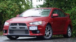 mitsubishi lancer evolution vs subaru wrx sti used vehicle comparison