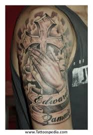 cross with praying hands tattoo with clouds