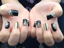 black and gold nails with pearls and rhinestones nails nails