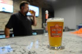 broncos breckenridge brewery team up for beer united in orange