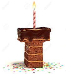 letter t shaped chocolate birthday cake with lit candle and