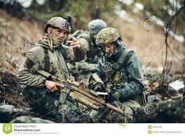 soldiers on the outdoor of looking at the map stock photo image