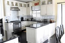 staten island kitchens black cabinets with black countertops blue white island large