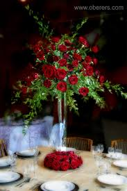 Trumpet Vase Wedding Centerpieces by Silver Trumpet Vase With Red Roses And Mixed Greenery Lovely