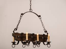 old and vintage wood and black iron chandelier with candle holder