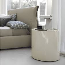 bedroom white round nightstand on wooden floor and rug for