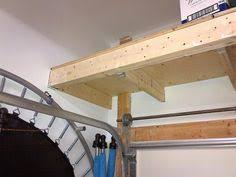 my above garage door storage loft the garage journal board
