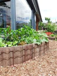 Curved Garden Wall by Raising Garden Beds Using Concrete Roof Tiles