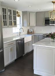 small kitchen grey cabinets we this stylish gray kitchen with goldhardware