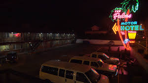 a 1950 u0027s neon sign welcomes travelers to a classic old roadside