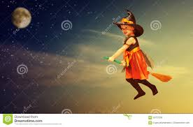 halloween witch child flying on broomstick at sunset night sky