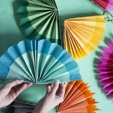 how to make a paper fan learn how to make these paper tissue fans to hang on a garland
